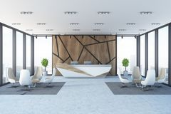 Wooden wall pattern office reception, armchairs. Modern panoramic office with wooden walls with a geometric pattern, a reception and two sets of armchairs and Royalty Free Stock Photos