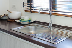 Modern pantry with sink and faucet on wooden counter Royalty Free Stock Photography