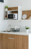 Modern pantry with utensil and sink. In kitchen royalty free stock images