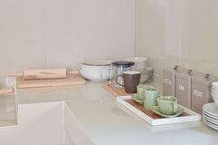 Modern pantry with white utensil in kitchen. At home royalty free stock photography