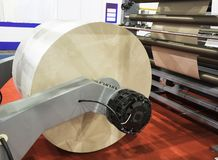 Modern paper cutting machine. Roll of white paper in modern paper cutting machine factory mill industry production press pulp rolls newspaper background nobody royalty free stock image