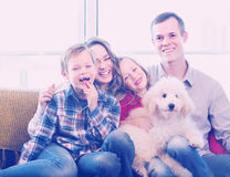Modern parents and children happy to spend time at home. Modern parents and children happy to spend time together at home stock images