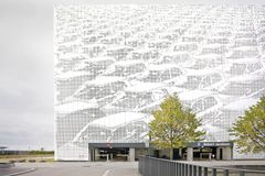 Modern parking building with metal perforated facade Royalty Free Stock Photo