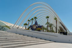 Modern part of Valencia in Spain. Modern buildings in Valencia, Spain, in front of a blue sky. We see a little garden with palm trees. In the foreground is a royalty free stock images