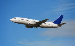Modern passenger jet. Boeing 737 jet airplane in flight Stock Image
