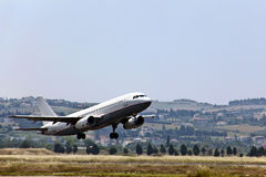 Modern passenger jet airplane landing. Modern passenger jet airplane landing at urban airport stock image
