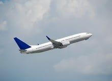 Modern passenger jet taking off. Boeing 737 state of the art passenger jetliner taking off royalty free stock photography