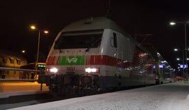 Modern passenger train on the railway station Royalty Free Stock Photos
