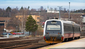 Modern passenger train stands on small station Stock Image