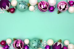 Christmas bauble double border on a turquoise background stock photos