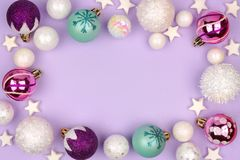 Pastel Christmas bauble frame over purple Royalty Free Stock Photos