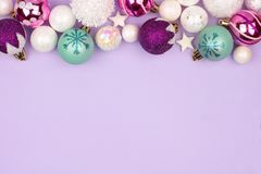 Pastel Christmas bauble top border over purple Stock Photography
