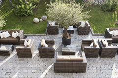 Modern patio. Garden patio with tables and chairs Stock Photos