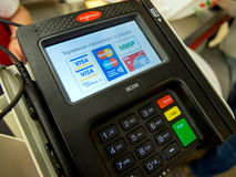 Modern payment terminal plastic card holder Royalty Free Stock Images