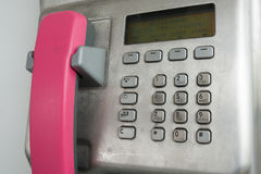 Modern payphone on the city street Royalty Free Stock Photos
