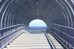 Pedestrian bridge modern balustrade. Spirally designed pedestrian bridge -  inside view - heading towards a beach in Australia Stock Photos