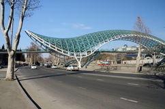 Modern pedestrian futuristic Bridge of Peace over Kura ,Tbilisi Royalty Free Stock Photos