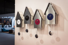 Modern pendulum clocks on display at HOMI, home international show in Milan, Italy Stock Image