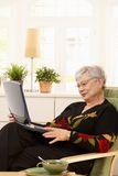 Modern pensioner with laptop Royalty Free Stock Images
