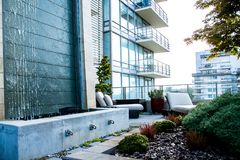 Modern High Rise Condo in Canadian City. A modern penthouse condo with patio gardens and city views in Victoria, British Columbia Stock Images