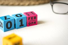 Perpetual calendar set at the date of February 1st. Modern perpetual calendar composed of colored cubes and set at the date of February 1st royalty free stock photos