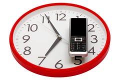 Modern phone and clock Royalty Free Stock Photos
