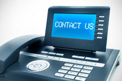 Modern phone with a display. Modern phone with a contact us sign on a display Stock Photo
