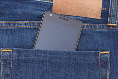 Modern phone in jeans pocket displaying screen Royalty Free Stock Photography