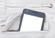 Modern phone in jeans pocket displaying screen Stock Image