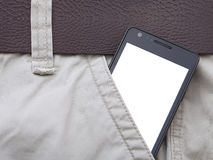 Modern phone in jeans pocket displaying screen Royalty Free Stock Photo