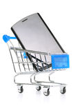 Modern phone in shopping cart Stock Images