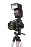 Modern photo camera with flash on tripod Royalty Free Stock Photography