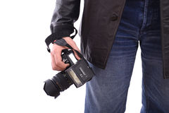 Modern photo SLR camera in photographer's hand. A modern photo digital SLR camera in photographe'rs hand with flach gun attached Royalty Free Stock Image