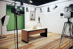 Modern photo studio with furniture and old style movie camera royalty free stock photos