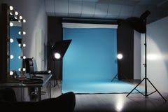 Modern photo studio interior. With professional lighting equipment royalty free stock photography