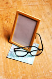 Modern photoframe with glasses Royalty Free Stock Photo