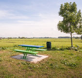 Modern picnic table and benches in a rural area Royalty Free Stock Images