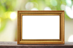 Modern Picture Frame placed on a wooden floor. Modern Picture Frame placed on a wooden floor hand have copy space to work input your idea Stock Images