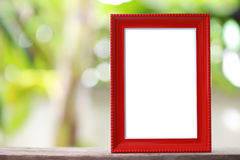 Modern Picture Frame placed on a wooden floor. Modern Picture Frame placed on a wooden floor hand have copy space to work input your idea Royalty Free Stock Photo