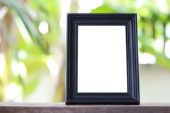 Modern Picture Frame placed on a wooden floor. Stock Photo