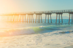 Modern pier during sunny bright day and wavy ocean Stock Photography