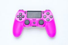 Modern pink plastic gamepad. & x28;joystick& x29; on gray background. Top view royalty free stock photography