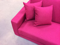 Modern pink sofa. Bright modern pink sofa with two cushions Royalty Free Stock Photo