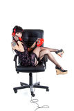 Modern pinup girl in office armchair Royalty Free Stock Image