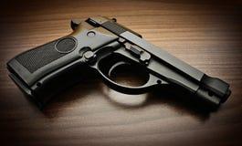 Modern pistol background Stock Photo