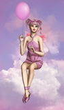 Modern Pixie. A little fairy sitting on a cloud and a balloon in her hand Stock Photography