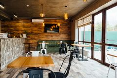 Modern pizzeria interior with gray plaster on the walls royalty free stock photography