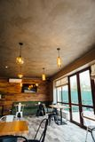 Modern pizzeria interior with gray plaster on the walls stock images