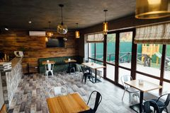 Modern pizzeria interior with gray plaster on the walls stock photo