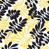 Modern plant pattern. Yellow and black tropical leaves seamless Stock Images